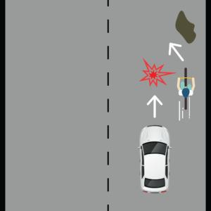 Cyclist Avoiding Potholes