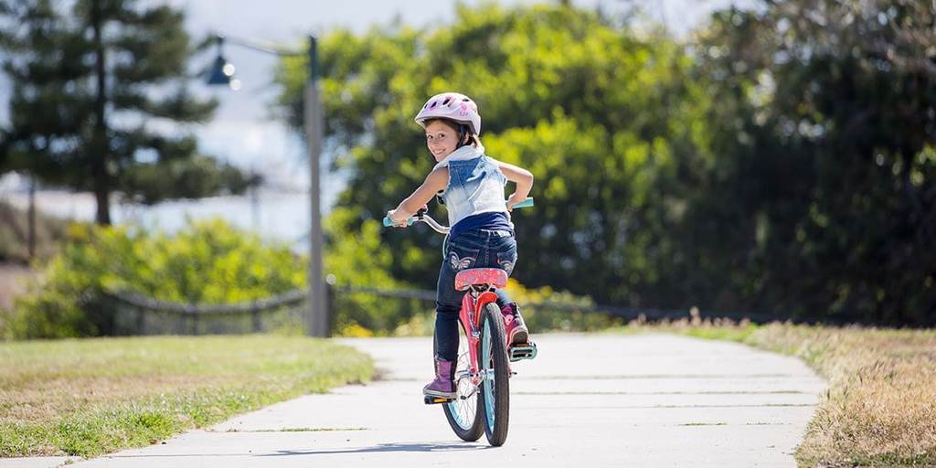 A Girl Riding Push Bike