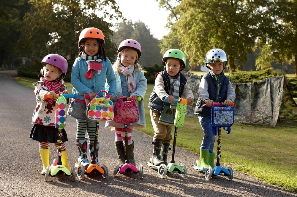 5 Kids Riding Scooters