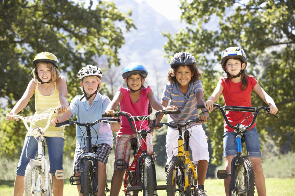Group of Kids Riding Bicycles